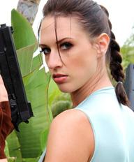 Busty Lana Kendrick gets in costume as Lara Croft to celebrate Halloween