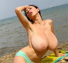 Naughty busty babe Anya sun bathing naked outside