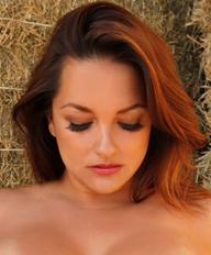 Monica Mendez with haystacks